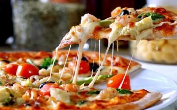 تناولوا البيتزا واخسروا وزناً